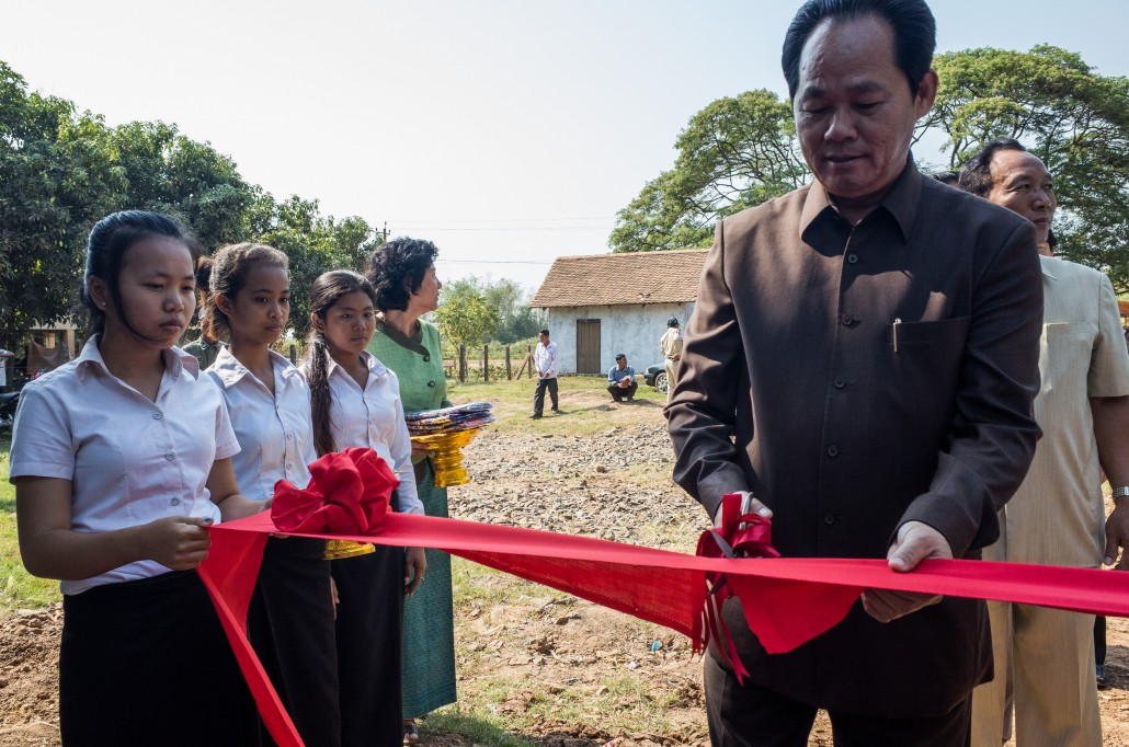 Cambodia's Minister of Rural Development H.E. Chea Sophara cutting the ribbon at the opening of a new water treatment plant in Tbong Khmum province.