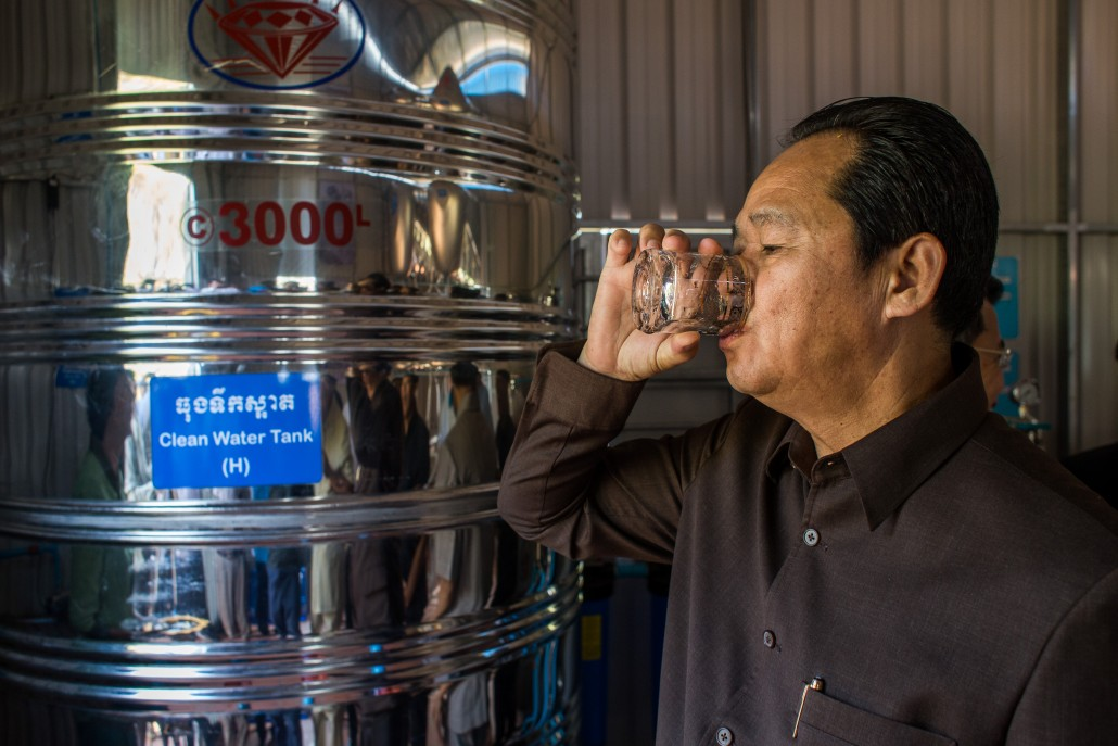 Cambodia's Minister of Rural Development H.E. Chea Sophara sampling water from the recently completed treatment plant.