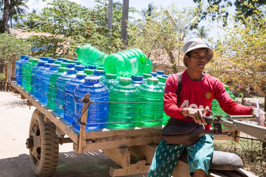 Mr. Nhen Bunthorn, Community Water Entreprenuer in Koah Roka commune, Prey Veng Commune Cambodia. Mr. Nhen has expanded his business by buying this delivery truck so he can deliver water to households and schools himself.
