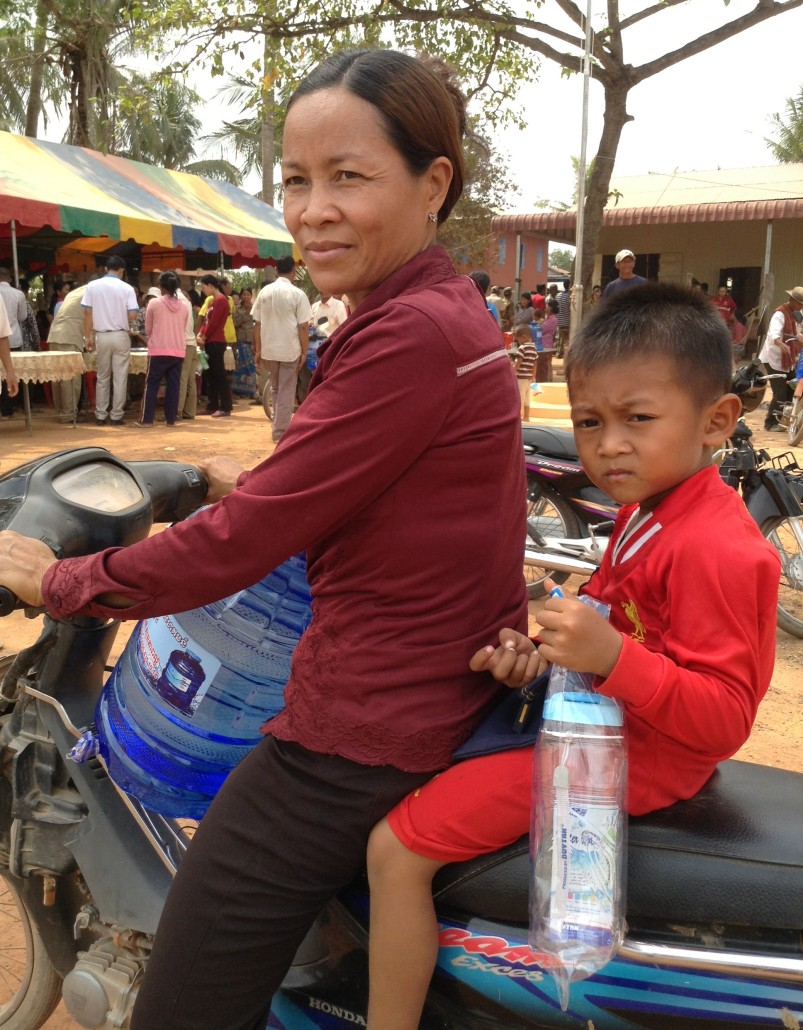 Ms Tark Sanith purchased clean bottled water at the handover event in Banteay Meanchey Province, Cambodia, on 16 March 2016.