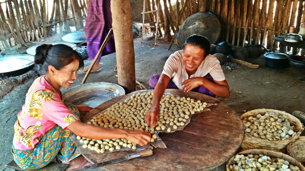 Women in Tetma village making jaggery (honey and candy) for trade