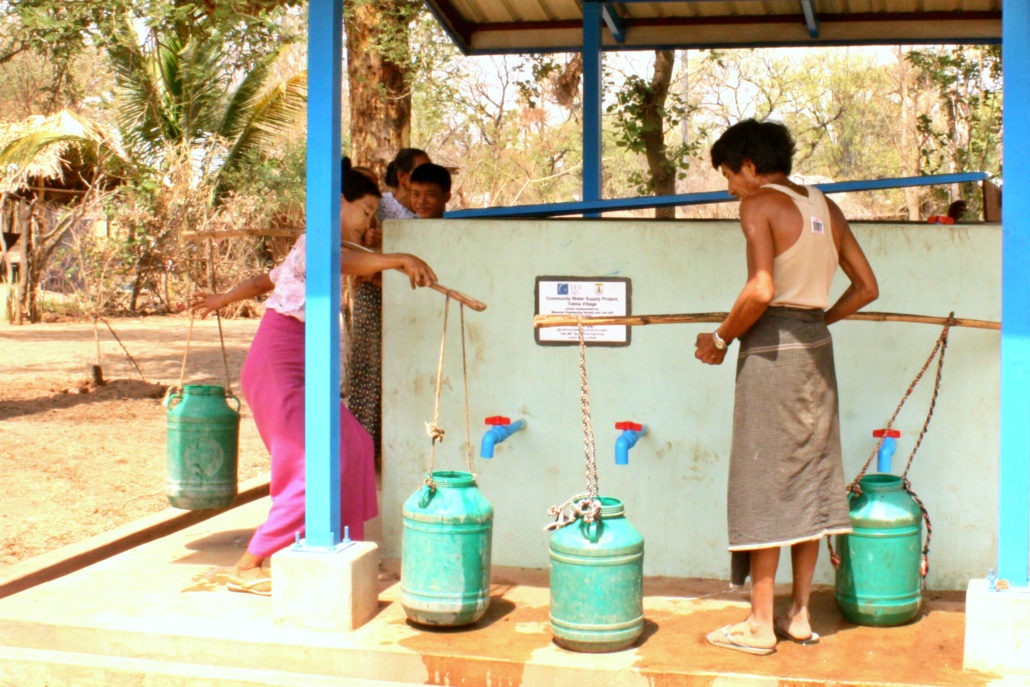 Villagers collecting water at one of the water points