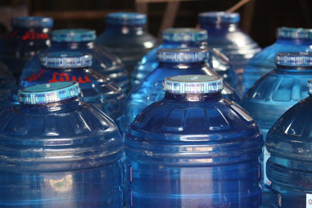 Bottles of clean treated water in the CWE treatment plant in Pou Andait Village, Kanchor Commune.