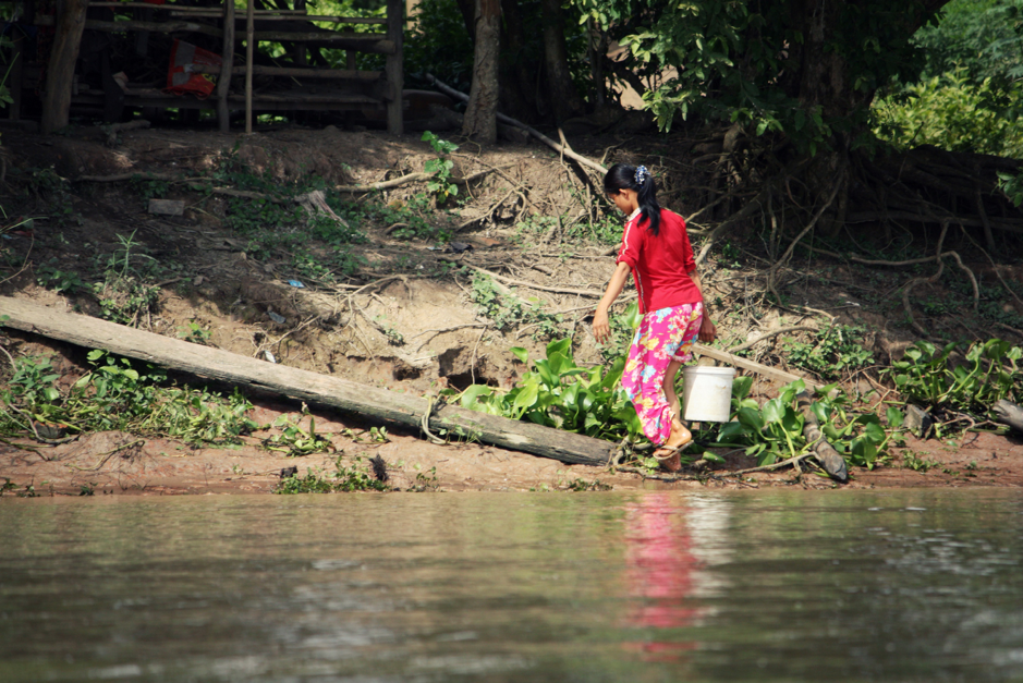 A girl fetching water. Before Community Water Enterprise (CWE) came to the village, Se Hin sometimes had to make multiple trips to fetch water with buckets.