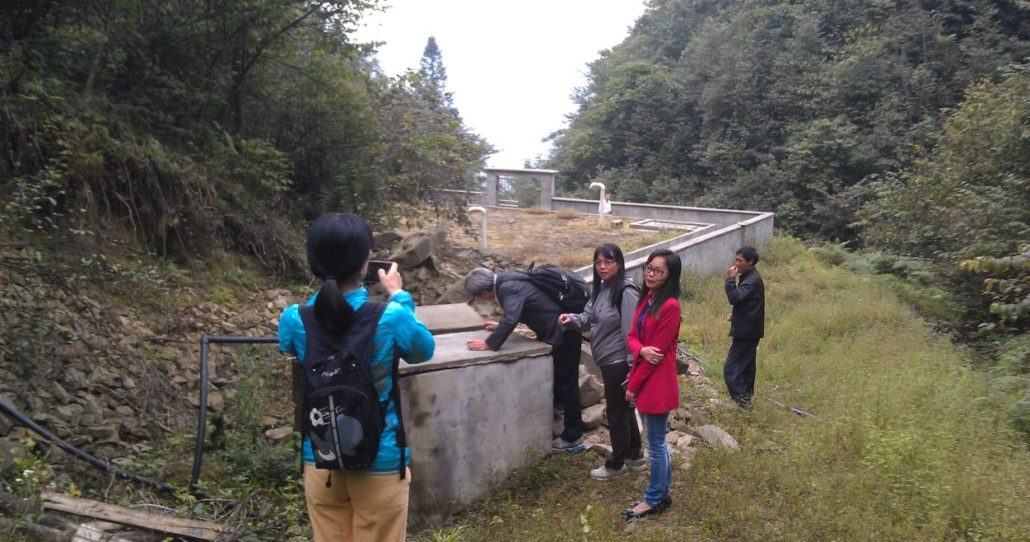 Zhangli, the village head and Lien AID at a site visit to the completed project