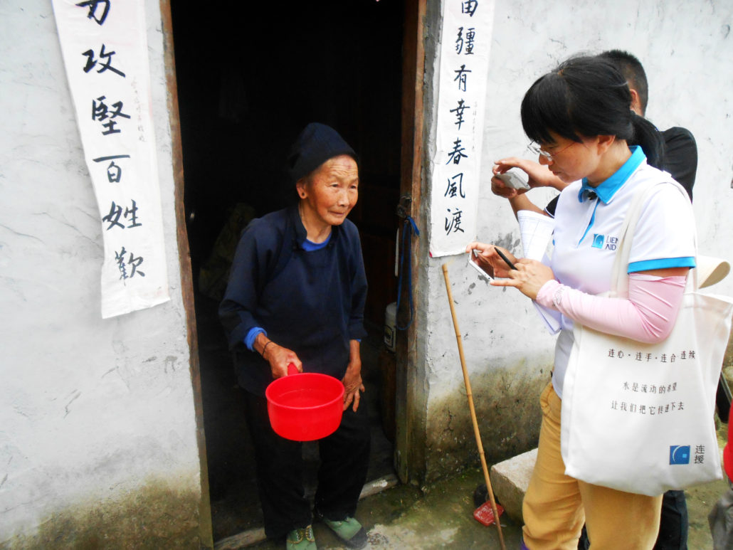 Lien AID staff conducting a field visit in China