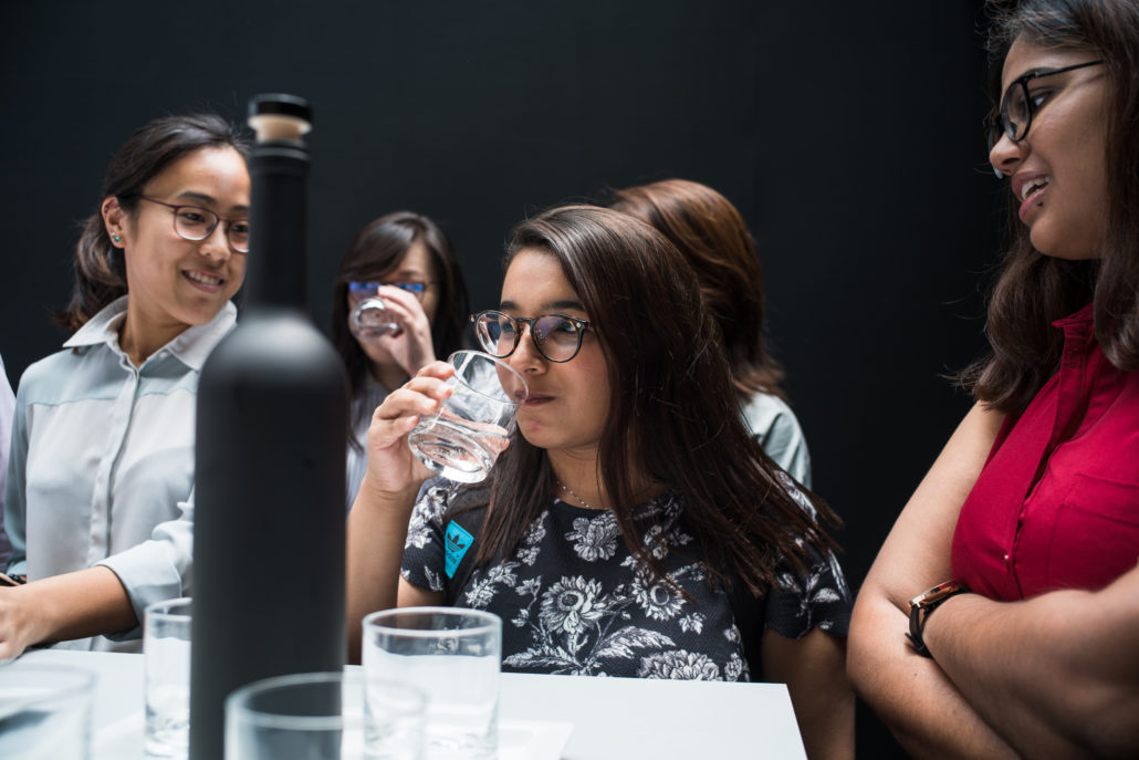 "Guests taste the ""luxury"" water at our event launch."
