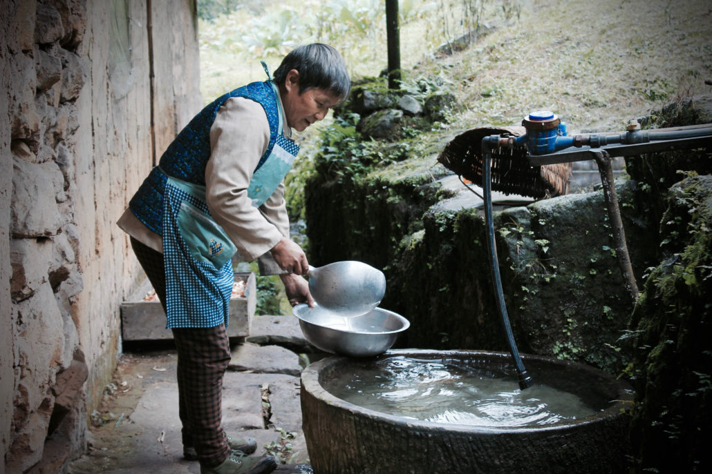 Wang Bangxian, a villager in Tiantaishan village, China, gains access to clean piped water through the Village Water Management (VWM programme).